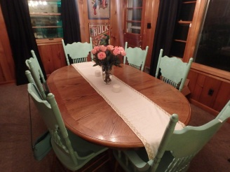 mint chairs, wood paneled dining room