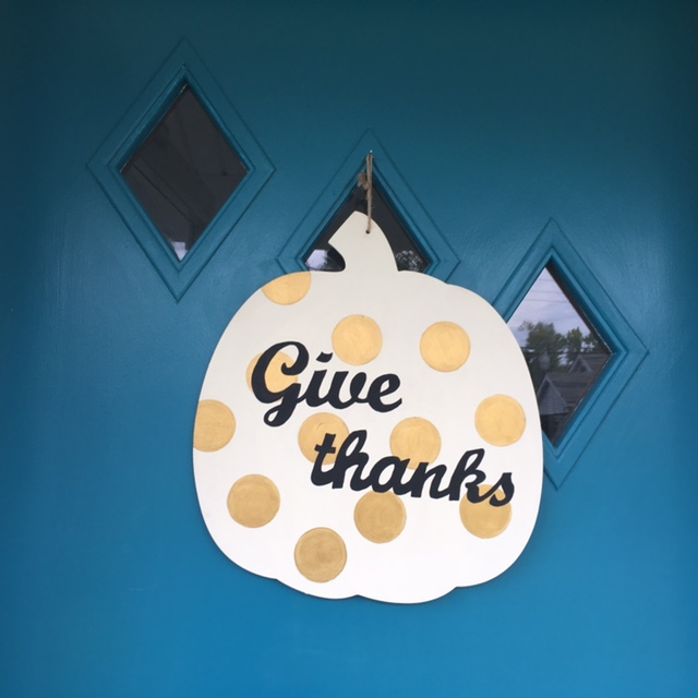 Polka dot pumpkin door decoration